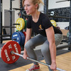 Power & Fitness Damen-Shirt beim Langhanteltraining